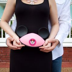 Hmm, maybe a simple reveal of pink or blue mouse ears?