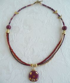 Deep Cranberry and Gold African Kazuri Necklace by fairchic