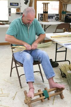 A student works on his project in a broom making class at the John C. Campbell Folk School   folkschool.org