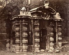 "This water gate stood at the river's edge, fifty yards from Samuel Pepys' house. Built in 1626, as the triumphal entry for the Duke of Buckingham to York House, since the Victoria Embankment was completed in 1870 it has been marooned a hundred yards from the Thames.  ""In Search of Relics of Old London"" Spitalfields Life"