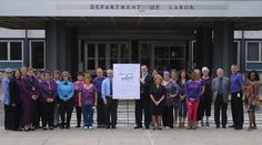 Labor Department staff in Albany show support for ending domestic violence. #shinethelight #NYSpurple