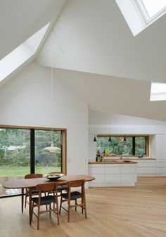 Completed in 2013 in Denmark. Images by Åke E. Village House Powerhouse Company was asked to design a weekend house for a young family in northern Sjælland, Denmark. Village House is an. Küchen Design, House Design, Design Ideas, Danish Interior Design, Modern Interior, Casa Hotel, Weekend House, Roof Architecture, Installation Architecture