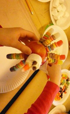 Thanksgiving Kids Crafts - Turkey made from apple, cereal, candy, mashmallow and toothpicks