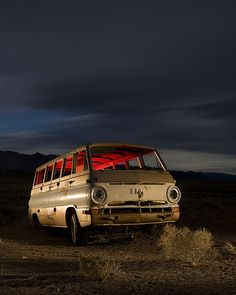 Early-'60s Dodge A100 van under summer storm clouds. Kincaid Mine, Nevada.    Night, 4 minute exposure. Full moon (mostly occluded), natural flashlight and red-gelled strobe.