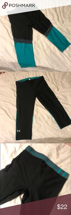 Under Armour black workout pants Under Armour black workout pants with blue on the bottom of the back of the pant legs. These are cut off pants and go a few inches below the knee. Under Armour Pants Leggings