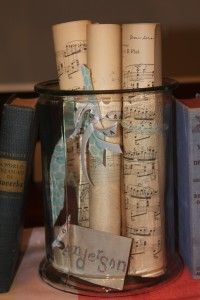 rolled up sheet music in a jar. would look good on a piano. @Christina Childress Satko should do this
