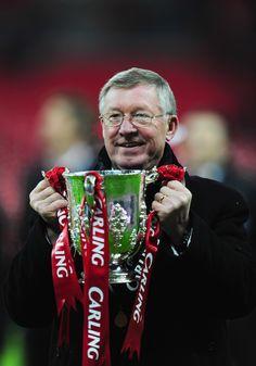 Former @manutd manager Sir Alex Ferguson holds up the Carling Cup following success against Wigan in 2006.