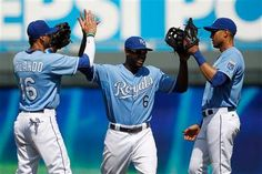Kansas City Royals' Paulo Orlando (16) Lorenzo Cain (6) and Alex Rios (15) celebrate their 5-1 win over the Houston Astros at the end of a baseball game at Kauffman Stadium in Kansas City, Mo., Sunday, July 26, 2015.
