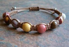 """Mookaite Healing Energy Bracelet.  Mookaite Jasper is found only in Western Australia. """"Mooka"""" in Aboriginal language means running water. Promotes self-confidence and self worth Strengthens personal power and helps one reach their full potential Increases strength and vitality Helps to connect to Nature and energies of the Earth.  http://zenjewelry.mysticnaturals.com/mookaite-jasper-healing-energy-bracelet/"""