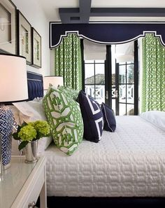 French doors. bedroom with navy and green decor