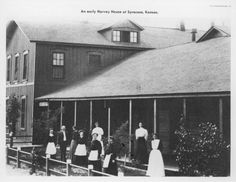 Photo of Harvey Girls standing outside of the Harvey House at Syracuse, Kansas,