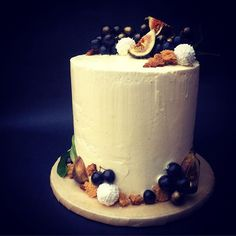 Whisky and Ginger Cake. Covered in black and gold grapes and figs. Made by Campbell & Love. London. enquiries@campbellandlove.com