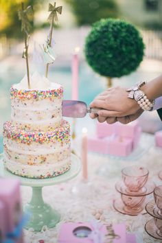 Funfetti wedding cake. Naked cake. Pastel cake table and dessert table decor. Cutting the cake. | Retro Pastel Inspired Shoot | Lovelyfest Event Design
