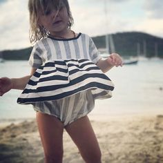 A twirling beach babe in our voyage playsuit.  thank you to our lovely stockist @cloth_shoppe for this adorable little moment! // a handful of these playsuits are available online. if you don't see your size check out our 'stockist' section. They may have what you're looking for. #carlymegan #youandmeandthesea16