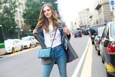Chiara Ferragni in a printed Fendi jacket, grey hoodie, slogan t-shirt and skinny jeans, carrying a denim Chanel bag.