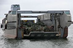 Part of the equipment and 200 troops of the Canadian 5th mechanised brigade group, about to disembark frm a high speed landing craft from French Marine Nationale BPC Mistral, during Exercise Lion Mistral, 20-21 June 2014.