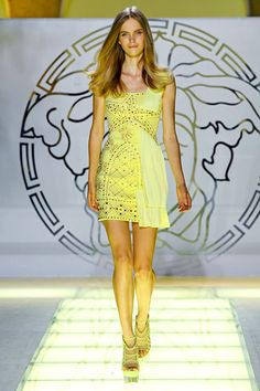 Versace Spring 2012 RTW.  Love the star and the flowing fabric on one side!