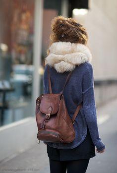 Brown rucksack, denim jacket, ivory muffler, black bottoms
