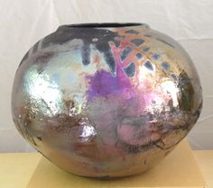 Pamela Zimmerman also has RAKU designs, dark clay pieces in which areas of the surface are unglazed for the dramatic contrast of glaze and clay body. Learn more about this artist and Pacific Fine Arts at http://pacificfinearts.com  #PacificFineArtsFestivals #FineArt #Festivals #Sculpture #Ceramics #Dishware #SetTheTable #Raku #FunctionalArt #Graphics #SiliconValley #BayArea #California SanFrancisco #NorthernCalifornia #SF