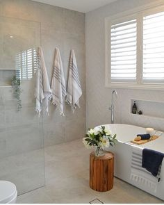 neutral bathroom design ideas, modern farmhouse bathroom design with white walls and walk in tile shower, metal mirror over bathroom vanity and bathroom sconces with cement tile floor and free standing bathtub hooks with turkish towels Bathroom Spa, Bathroom Renos, Laundry In Bathroom, Bathroom Layout, Bathroom Colors, Bathroom Fixtures, Bathroom Flooring, Bathroom Interior Design, Bathroom Renovations