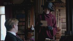 Mary has such an amazing taste in coats. This deceptively simple draped affair in maroon is beautiful. (Season 3)
