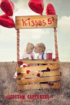 kissing booth - This one looks easy-ish. Balloons not a bad idea.