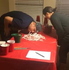 bobbing for candy canes a cute holiday party game