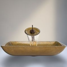 Create a bold look in your bathroom when you install this glass vessel sink with waterfall faucet. Featuring shades of gold and copper, this glass sink is an eye-catching addition to any bathroom. The waterfall faucet has an elegant, oil-rubbed finish.