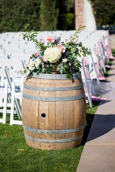 Old wine barrel decorated with beautiful spring. Wedding Reception Decor. Spring Barn Wedding - Bethaney Photography. Click http://www.confettidaydreams.com/romantic-spring-barn-wedding/