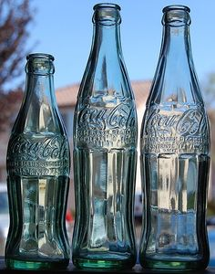 """Coca Cola Bottles, Bottles from left to right: 6 ounce, 10 ounce and 12 ounce. In the Coca-Cola introduced their new """"King-Size"""" bottles . by Roadside Pictures Antique Bottles, Old Bottles, Glass Bottles, Coca Cola Bottles, Pepsi Cola, Coke, Always Coca Cola, The Good Old Days, Photos"""