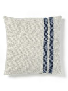 Handmade in the UK from pure wool with a duck feather inner, our luxurious cushion is super soft and warm, the perfect scatter cushion for your bed or sofa. Woven from soft cream wool with a blue double stripe, it will add a subtle pop of colour to your living space. Match with our Soft Wool Throw – Blue French Stripe.