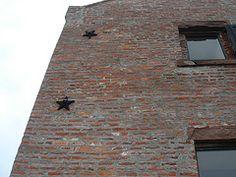 Masonry Star Anchor Plate on a building. Article on history of masonry stars.