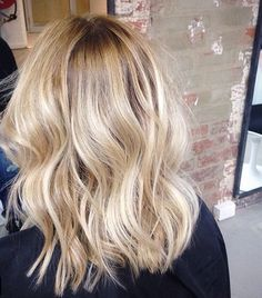 Natural looking ash blonde hair with highlights