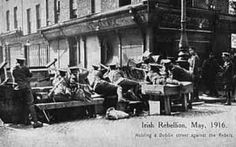 April British troops at a makeshift barricade, at a key point in the city, The Irish rebellion began on Easter Monday April 1916 when the Irish rebels attempted to gain control of public buildings in Dublin. (Photo by Popperfoto/Getty Images) Ireland 1916, Dublin Ireland, Dublin Street, Dublin City, Old Pictures, Old Photos, Irish Independence, Easter Rising, Irish Eyes