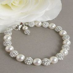 Beautiful white pearl and crystal pave ball bracelet.  BUY NOW http://jewelrybytali.com/products/pave-crystal-ball-white-pearl-bridal-bracelet-rhinestone-pearl-bracelet