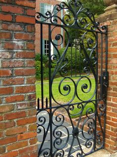 A private (formal) garden as seen through one of many wrought-iron gates in Charleston.
