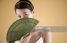 holding folding fans