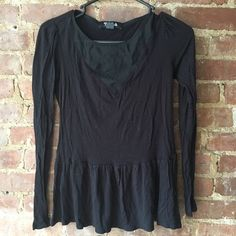 Black on black peplum top Soft black peplum shirt with a mesh v-neck. Perfect for a night out! From Urban Outfitters Tela Tops