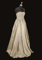 """Champagne satin evening gown, the bustier bodice and full skirts with heavy lace overlay. Made at MGM Studios in 1951, for the premier of """"An American in Paris"""" for Ms Blair, who was married to the film's star, Gene Kelley. Sold at Christie's auction for $1310"""