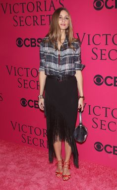 Your going-out look need not be too sexy, as Olivia Palermo proves a plaid shirt and fringed skirt hit just...