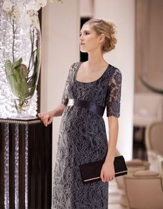 this one is a little looser under the tummy if you prefer not show all. Lace looks more woven then stretch. a bit more structured looking. NEck is too scooped for my liking.  250ish.