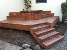 Beautiful redwood deck design with a custom Gordon and Grant redwood hot tub. www.gordonandgrant.com