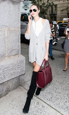 #5: Repurpose Your Cardigan // Candice Swanepoel layers a buttoned cardigan over a dress with thigh-high boots.