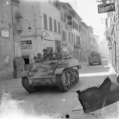 A Stuart reconnaissance tank and a Sherman of 6th Armoured Division in Arezzo, 16 July 1944.