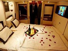 First Class Honeymoon. Couples can relax with rose petals, champagne, and a full bed when flying with Singapore Airlines. (.......someday.........)