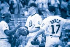 May 6, 1998  First baseman Mark Grace (left) and catcher Sandy Martinez celebrate Wood's 20-strikeout, 1- hit performance on May 6, 1998