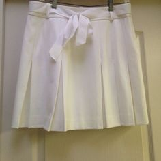 INC White pleated skirt White INC pleated skirt with ribbon tie-mid calf length. Only worn once. INC International Concepts Skirts Mini