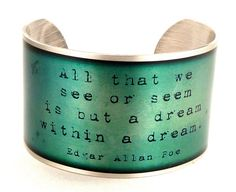All that we see or seem is but a dream within a dream. -Edgar Allan Poe    This quote is in black text against a background that changes from an