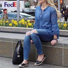 Love this blue lace top with lace up front detail. The perfect black bag, great skinny distressed denim. blonde beach waves.
