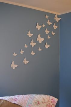 White paper butterflies on the wall, would be cute for a baby girls room